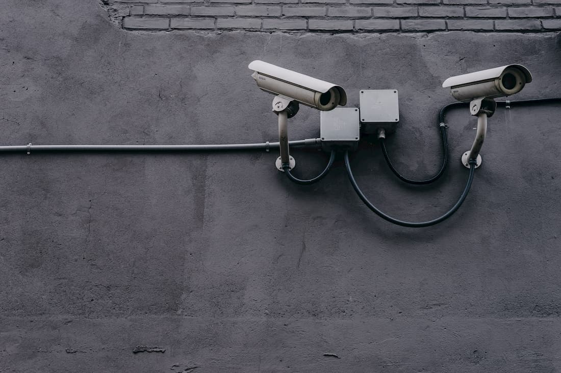 security cameras on a grey wall